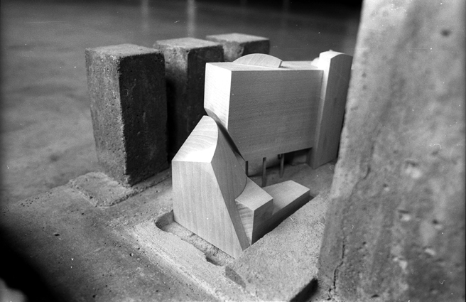 Site model with massing proposal 1:200. Reinforced concrete, bass wood.