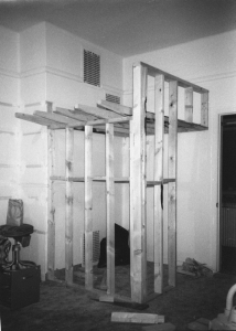 2 x 4 wood-frame structure of loft during construction. The round, cantilevered ladder rungs were inserted after the gypsum board was applied by means of drilling into three studs next to entrance.